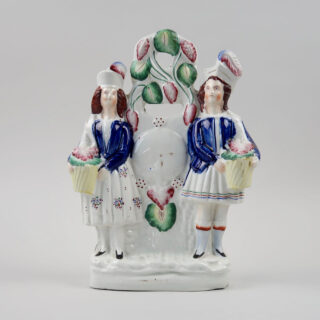 Staffordshire Figural Group - Couple with clock face and foliage