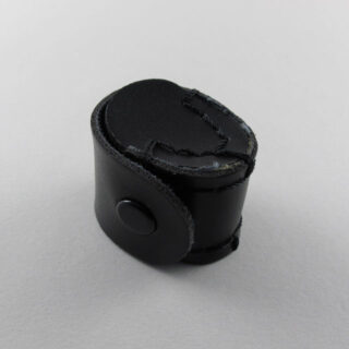 Loupe with 10 x magnification and blackened metal finish with leather pouch