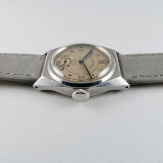 Dimra with Taubert Fils case circa 1940 | steel hand wound vintage wristwatch