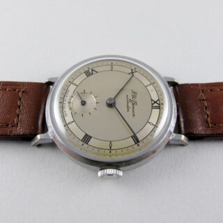 J. W. Benson/Smiths steel and chrome vintage wristwatch, sold in 1954