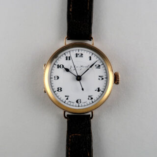 John Hunt, 1919   Early 9ct gold lady's vintage wristwatch with gold buckle