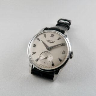 Longines Ref. 7033 invoiced 1959   steel manual vintage wristwatch