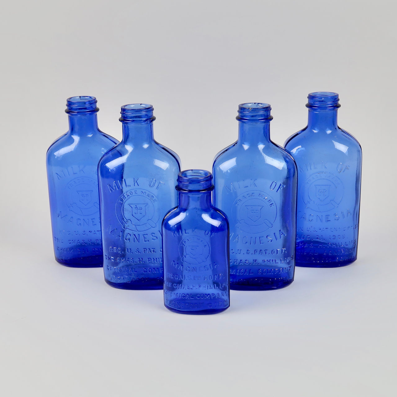 Vintage Glass Milk of Magnesia Bottles