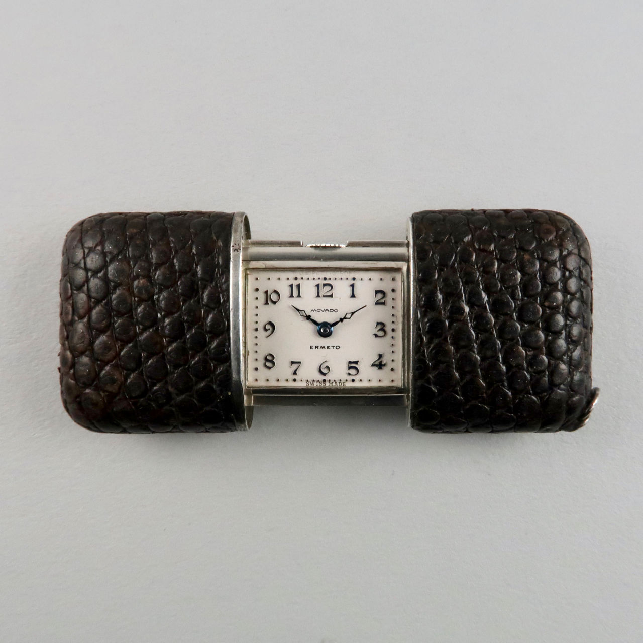 Movado Ermeto 'Baby' silver and leather covered purse watch 1929