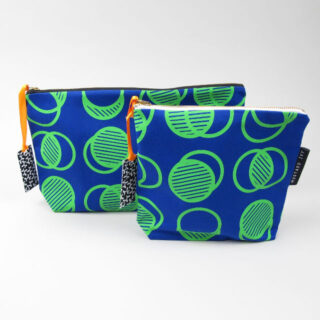 Zip pouches with screen printed green circle graphic