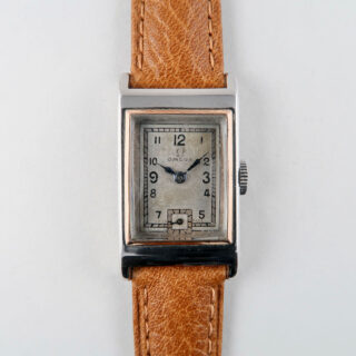 Omega Cal. T17 circa 1935   steel and pink gold rectangular hand wound vintage wristwatch