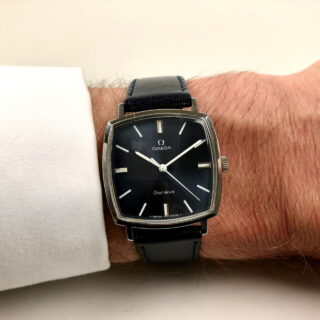 Omega Genève Ref. 131.022 circa 1970   steel cushion-form hand wound wristwatch with blue dial