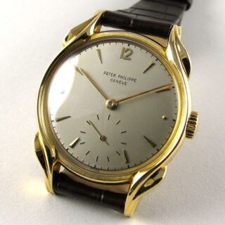 Gold Patek Philippe 'Flame Lugs' Ref. 2431 vintage wristwatch, made in 1950