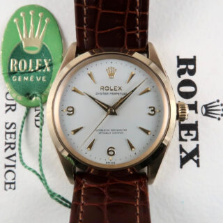 Rolex Oyster Perpetual Ref.1003 Chronometer 9ct gold vintage wristwatch, sold in 1964