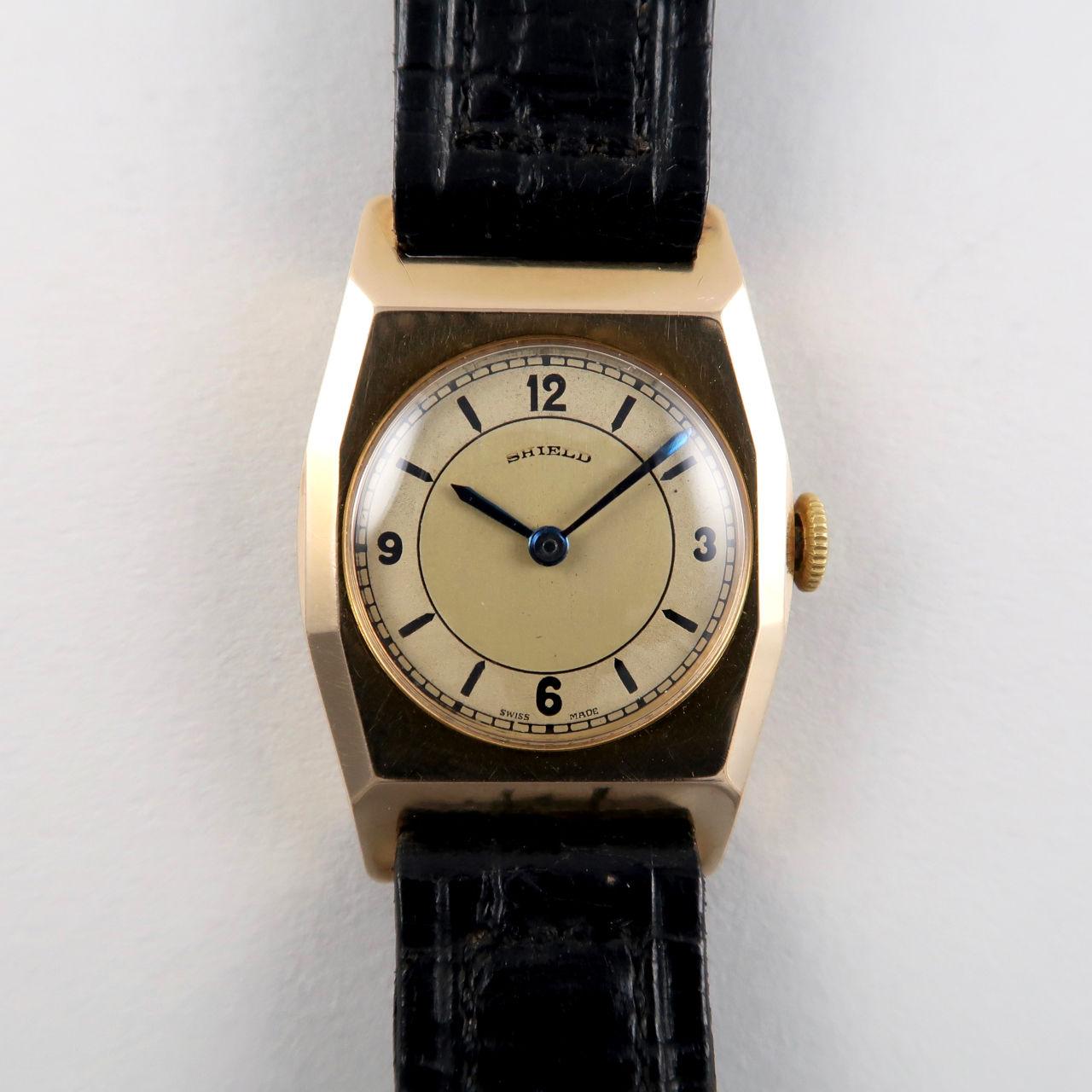 Shield gold vintage wristwatch, hallmarked 1935
