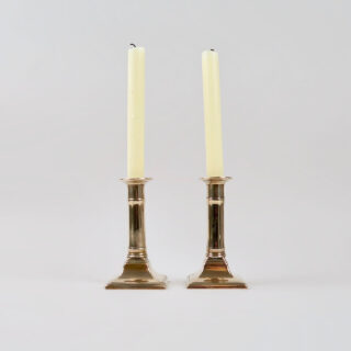 A Pair of Square Based Brass Candlesticks