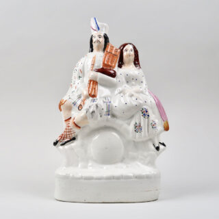Staffordshire Highland Couple with Clock Face