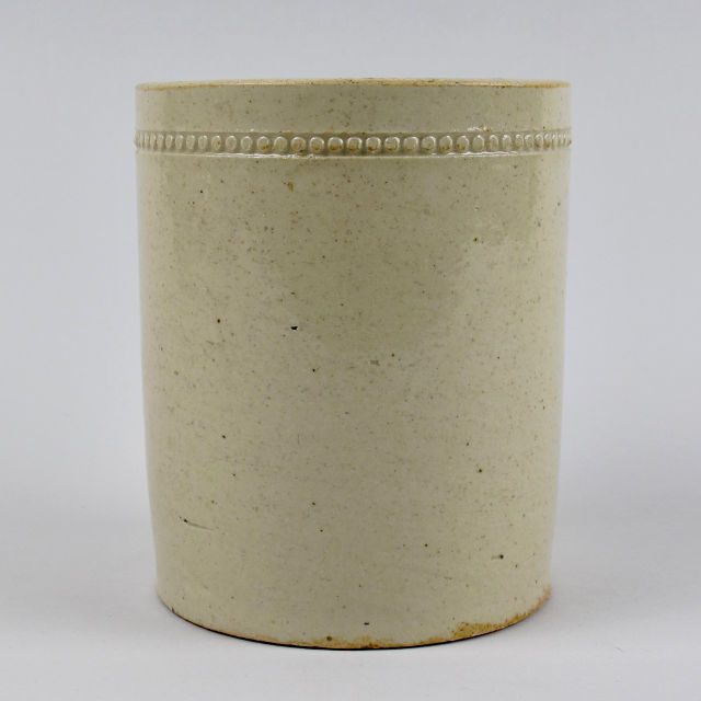 Stoneware jar with incised circle decoration