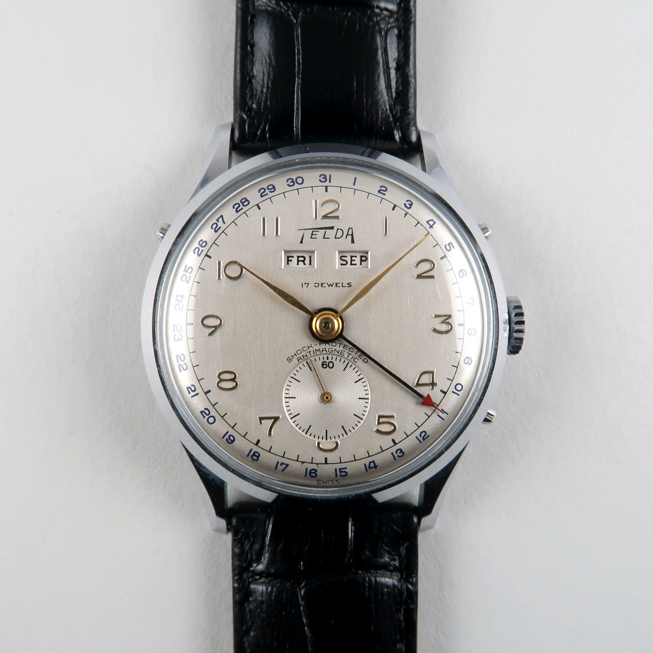Telda circa 1950   chrome & steel triple calendar vintage wristwatch